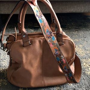 Brown purse with colorful cross body strap